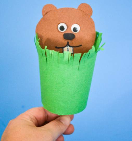 paper groundhog puppet popping out of grassy paper tube