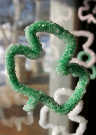 Shamrock made of pipe cleaner covered with crystals
