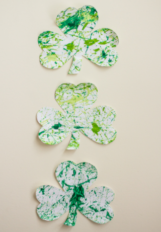 Marble painted shamrock made from a white paper