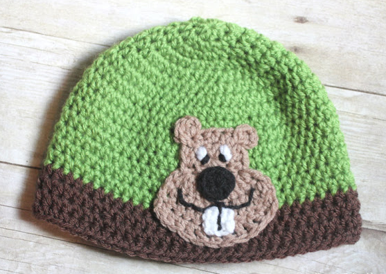 crocheted beanie cap with crocheted groundhog applique