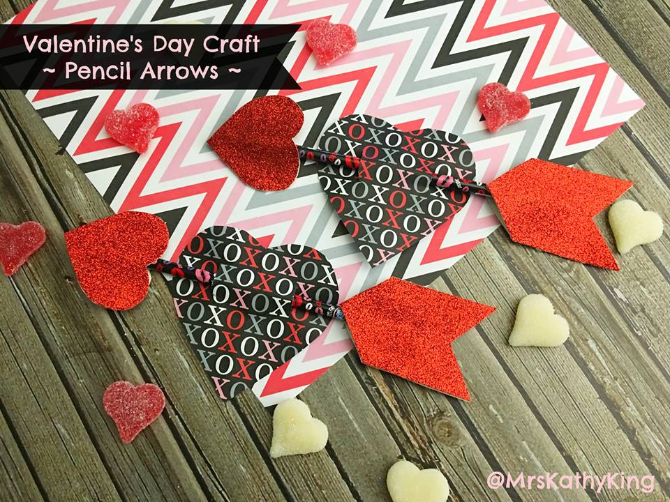 Valentine's day pencil arrow with a heart shape on the middle with a text xoxo.