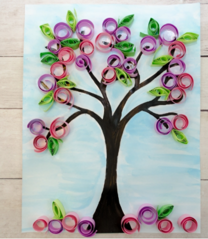 Cherry blossom painting added rolled pink and purple paper flowers and green paper leaves on it