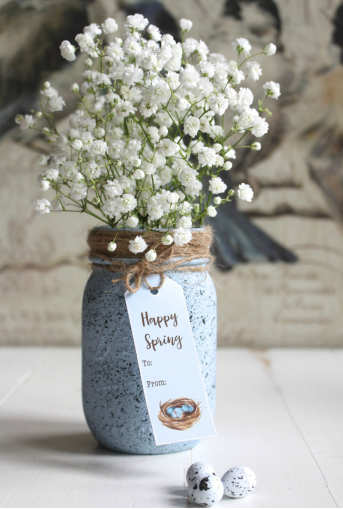 Specked Robin's Egg Mason Jar with a tag that says Happy Spring To: From: and a beautiful with flowers coming out