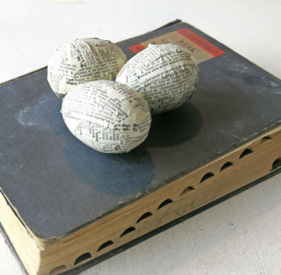 Plastic Easter eggs wrap with vintage book pages
