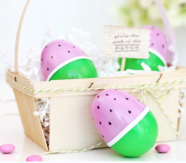Plastic Easter egg personalized as a watermelon on a basket