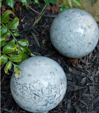Homemade concrete garden balls display