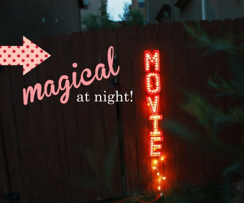 A homemade marquee sign for backyard movie night