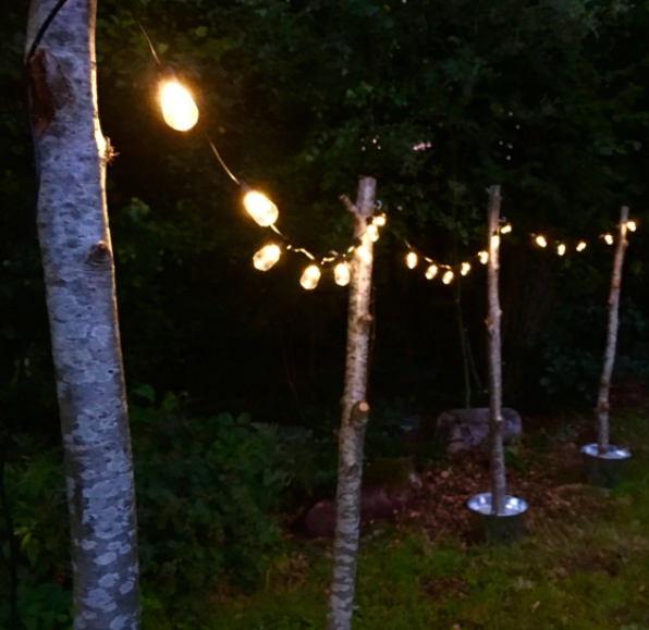 Homemade outdoor string light poles for movie nights