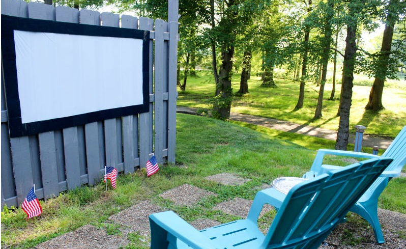 A cheap homemade outdoor movie theater and projection screen from dollar store