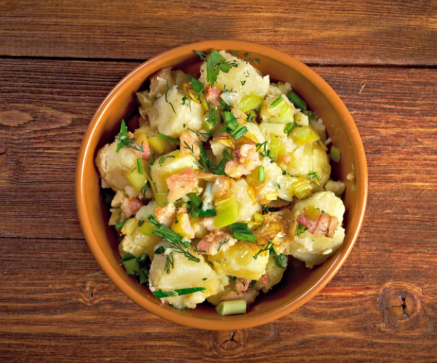 classic potato salad made with mayonnaise. With vinaigrette on it and lots of bacon