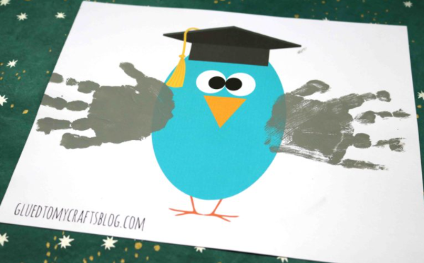 Super easy to make graduation handprint owl with graduation hat