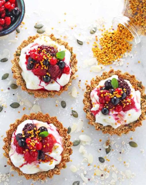 yogurt and berry breakfast tarts with granola crust