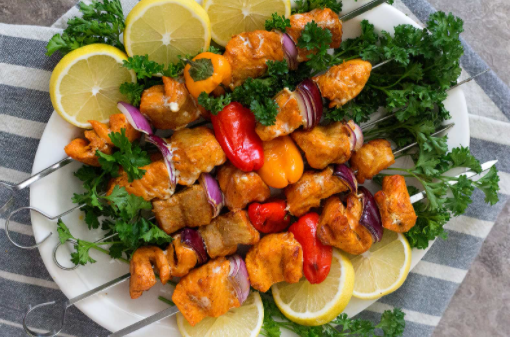 Healthy and delicious grilled salmon shish kabobs with lemons on the sidde