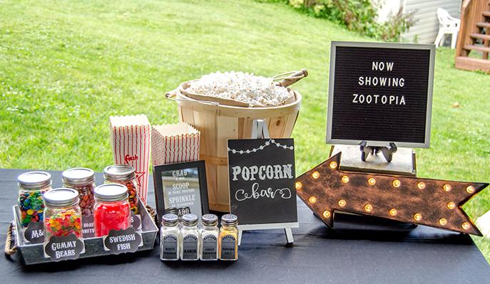 An outdoor movie night popcorn bar free printable
