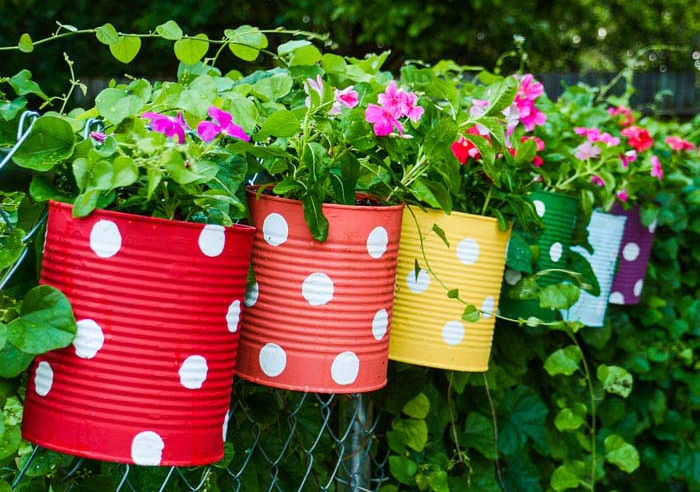 A colorful and homemade tin can flower fence garden