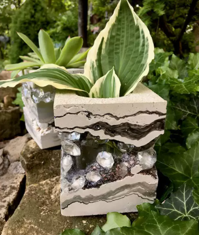 A unique and layered concrete and jewel vases
