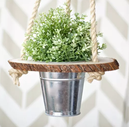 A wood slice hanging planter porch and garden display