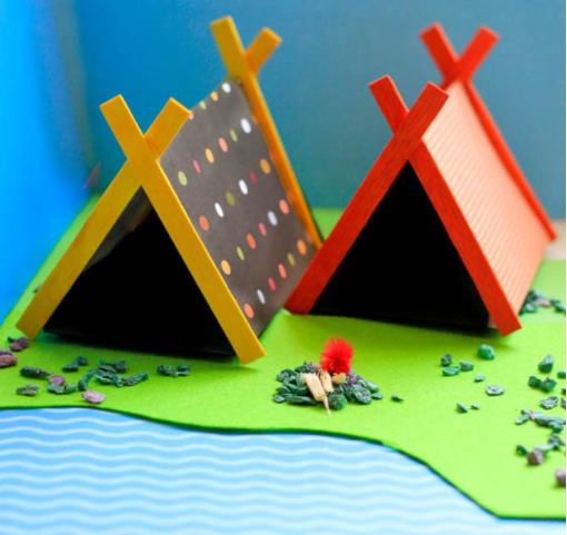 Mini camping tents built with sticks and papers