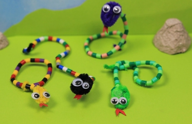 Snake crafts made from pipe cleaner and perler beads