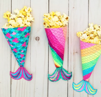 A magical and colorful mermaid movie night printable popcorn holder for the summer