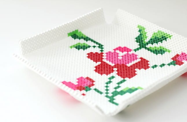 Perler bead tray with a vintage rose design on it