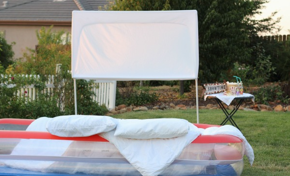 An outdoor movie screen for summer slumber party