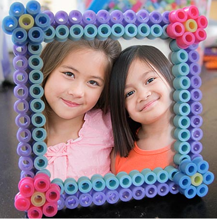 Perler bead picture frame that has a photo of two adorable kids on it