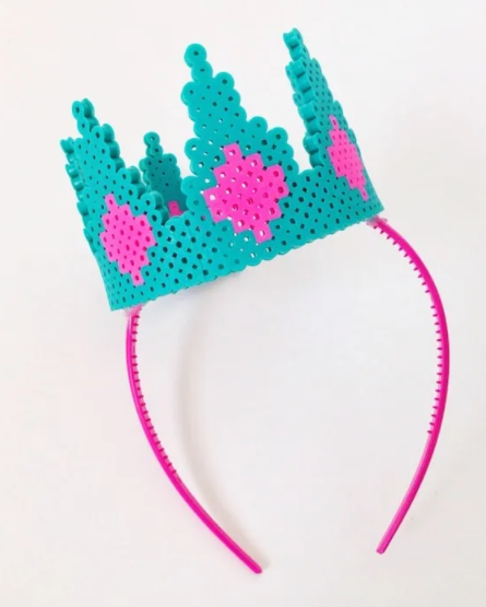 Adorable perler bead crown attached to a headband