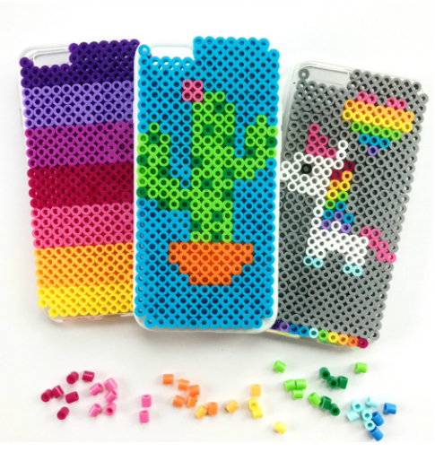 Three perler beads Iphone cases; one has a cactus design on it, second has a unicorn and a heart design on it and the third one has different colors perler bead design