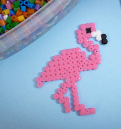 Adorable perler bead flamingo that is a fun project for the kids