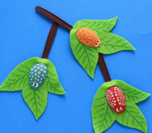 Plastic spoons turned into cute little bugs on branches