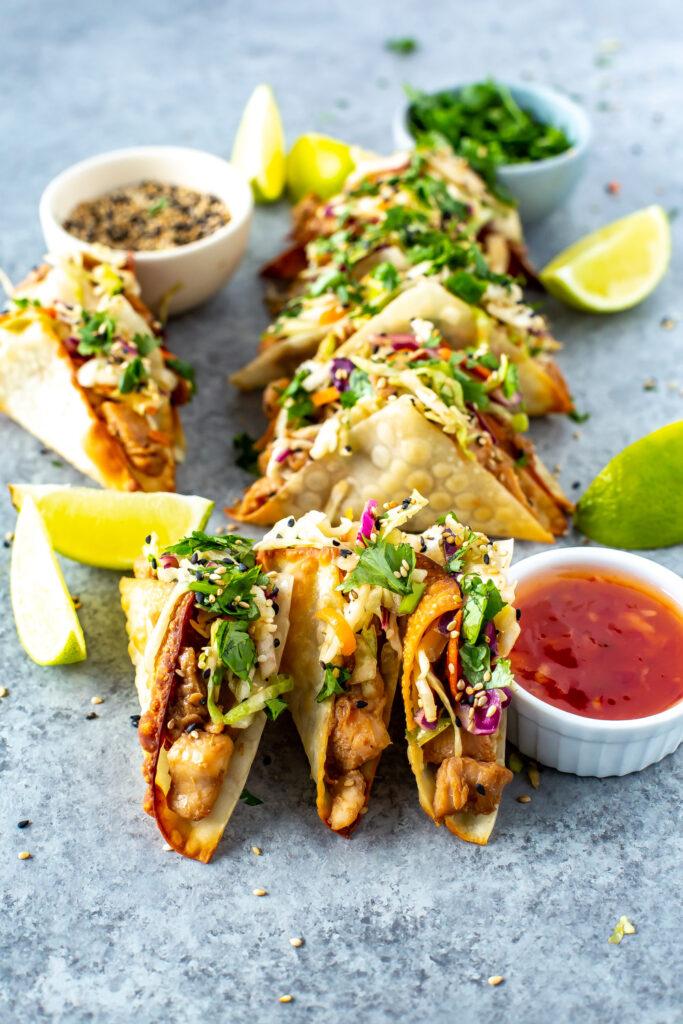 A applebees honey-garlic chicken wonton tacos made with  sweet chili sauce, Asian slaw in crispy wonton shell