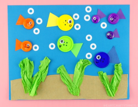 An easy to make button fish craft for kids this summer