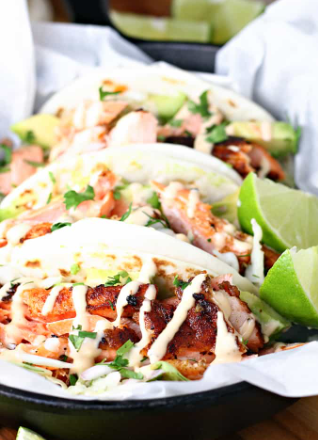 A seafood Chile lime salmon tacos with tortillas and tangy cabbage slaw