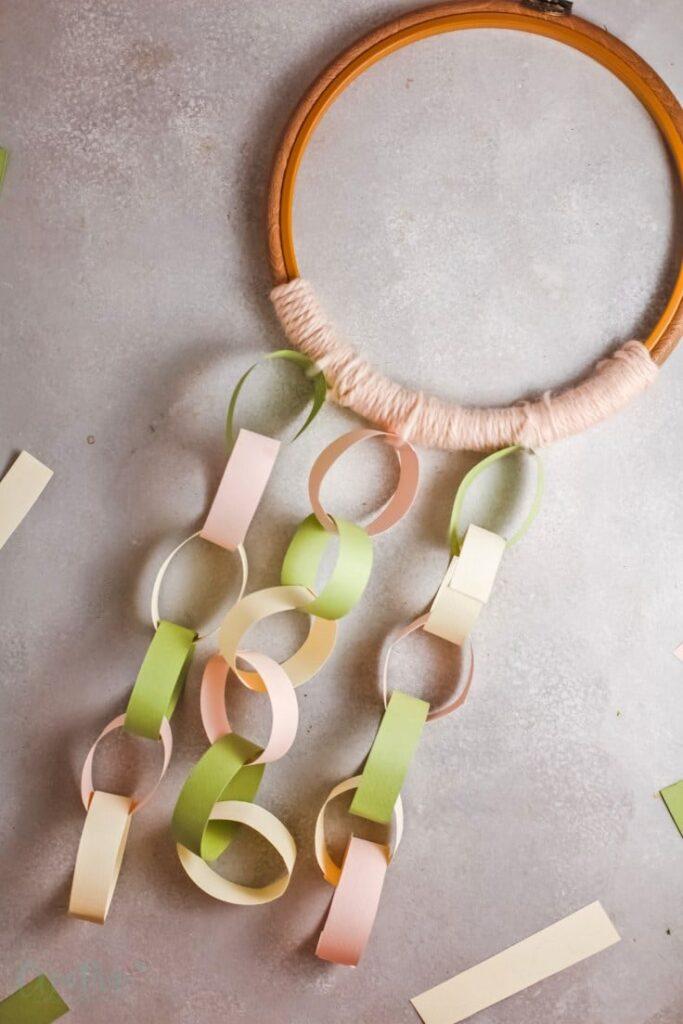 Embroidery hoop with a paper chain on it perfect for decoration