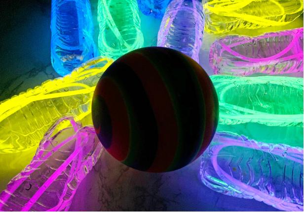 Glow in the dark bowling darkroom activity for kids