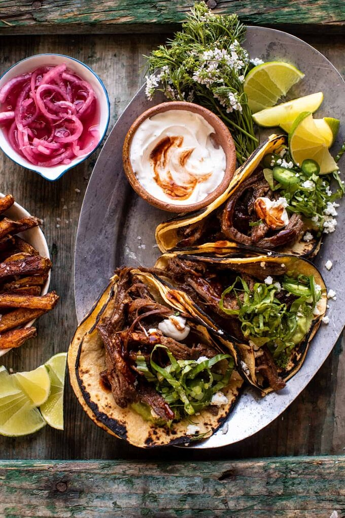 Fiesta style crockpot carne asada tacos with spicy baked Mexican street fries
