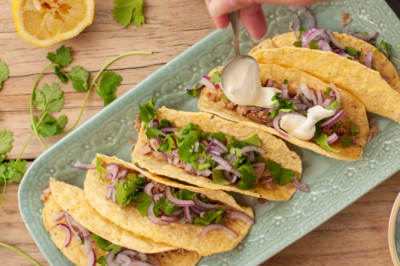 Quick and easy canned tuna fish tacos serve with chips and salsa black bean soup and rice