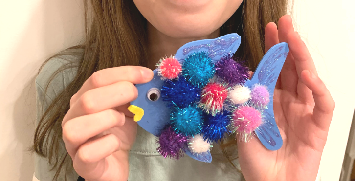 A colorful rainbow fish craft ornament for kids