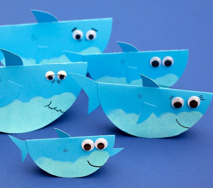 An adorable rocking paper shark family wobbling summer craft for kids