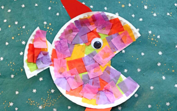A colorful paper plate and tissue tropical fish kids craft