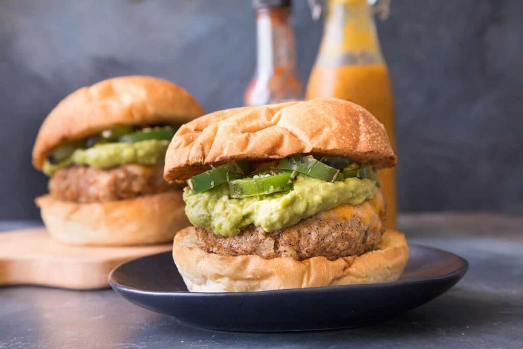 A grill perfect juicy turkey chorizo burgers with creamy guacamole