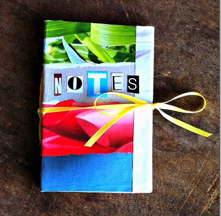 Recycled cereal box notebook perfect for kids journal of their memorable camping trip.