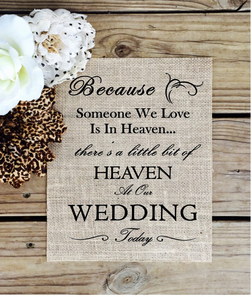 Burlap wedding sign with text saying Because Someone We Love Is In Heaven there's a little bit of HEAVEN At Our WEDDING Today