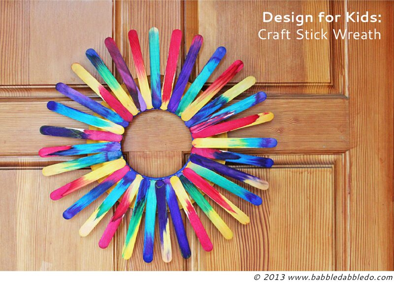 A handmade and colorful craft stick wreath door hanging home decor