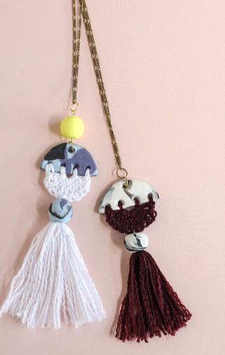 Two marbled clay with crocheted thread necklaces
