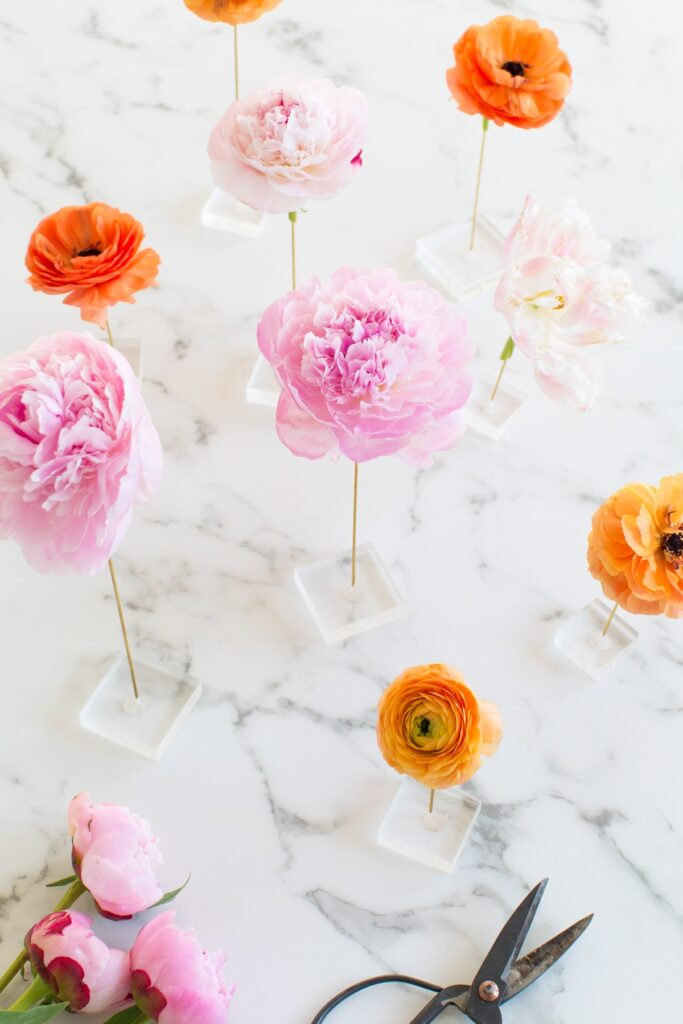 Colorful homemade floating flower table display perfect for party events decor