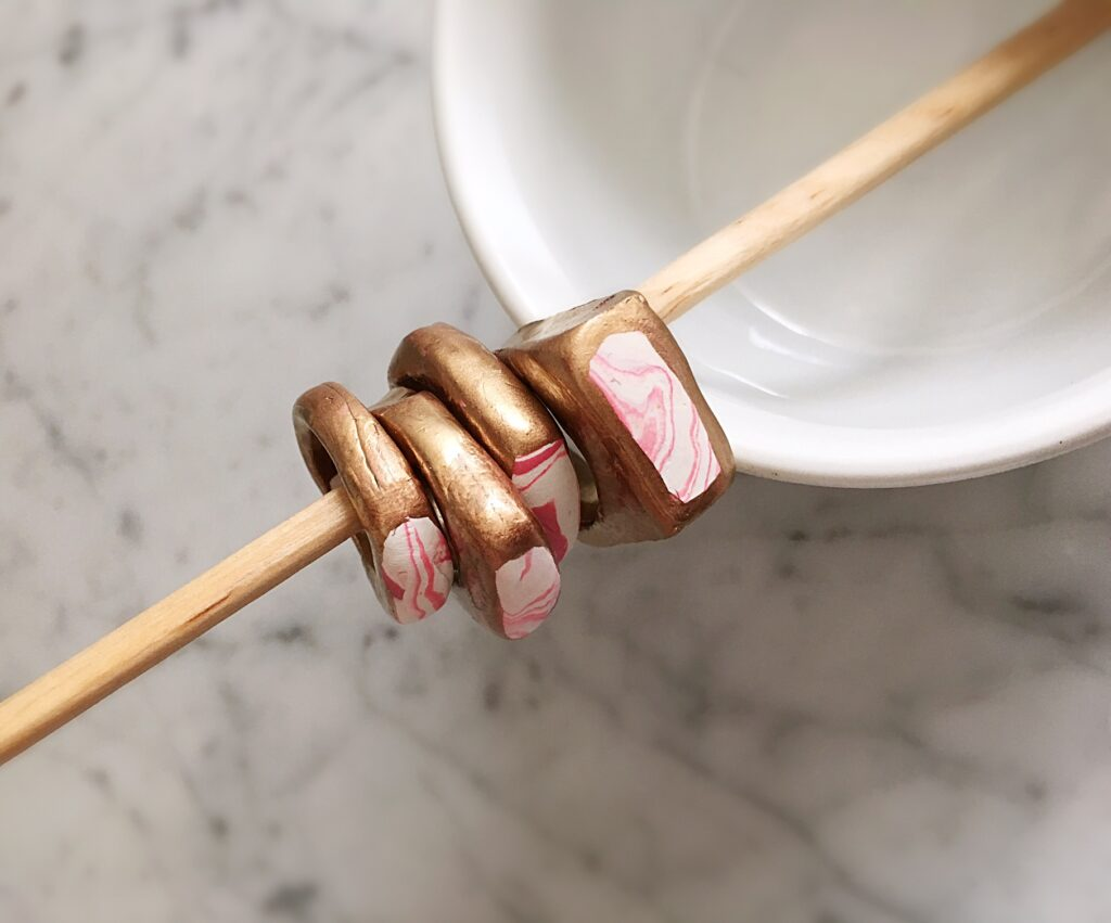 Marbled clay gold ring with pink custom design