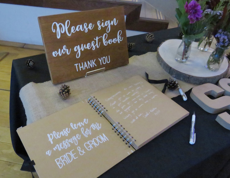 Wooden wedding sign says Please sign our guest book, Thank you.