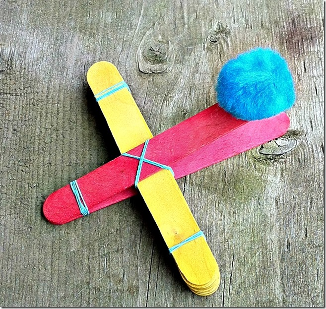 A homemade easy to make catapult craft made of popsicle sticks